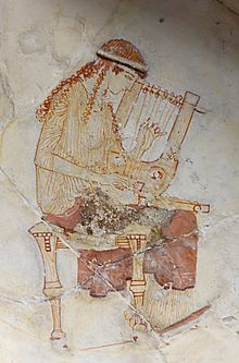 220px-Muse_lyre_Louvre_CA482