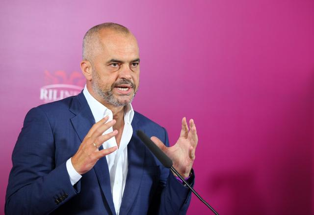 Opposition Socialist Party leader Edi Rama speaks during a news conference at party headquarters in Tirana, Tuesday June 25, 2013. The opposition Socialists are holding their lead as counting continues in Albania's election but a dispute over the makeup of the Central Election Commission could leave the outcome up in the air. Despite a shooting which left one dead, international monitors noted overall improvements in Albania's election — seen as key test for the country's hopes for closer ties with the European Union. (AP Photo/Hektor Pustina)